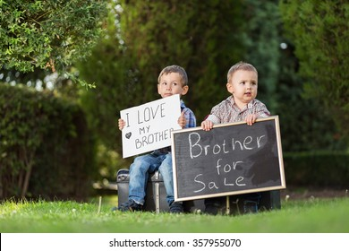 Kids in the park with sign boards for sale