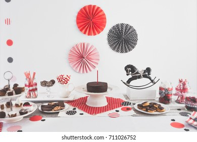 Kids party decoration objects table setting on white background. Vintage rocking horse toy concept. Paper decoration, confetti and candy sweets. Flat lay. To Editors this a resubmit: saved in sRGB now