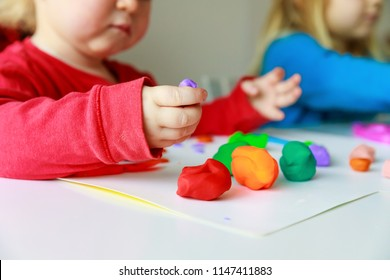 kids play with clay molding shapes