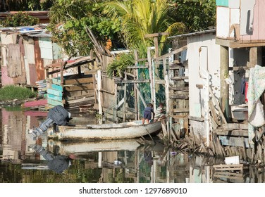 Kids play on a boat in a slum along the water in Honduras.