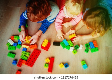 kids play with plastic blocks, learning concept