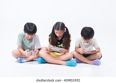 kids play playing tablet phone together online young social children boy girl asian