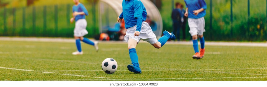 Kids Play Soccer Game. Children Outdoor Football Tournament Match on Grass Field