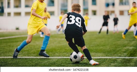 Kids Play Soccer Game. Children Outdoor Football Tournament Match on Grass Field