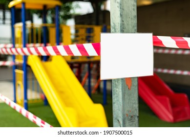 Kids playground caution taped off closed due to COVID-19