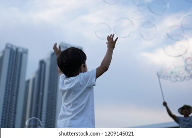 kids playing with bubble