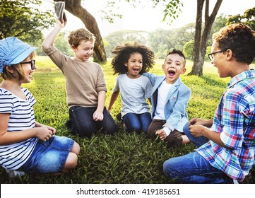 Kids Playing Cheerful Park Outdoors Concept