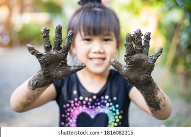 Kids playing with clay muddy. This activity is good for sensory experience and learning by touch their hands and fingers through clay and enjoying its texture.