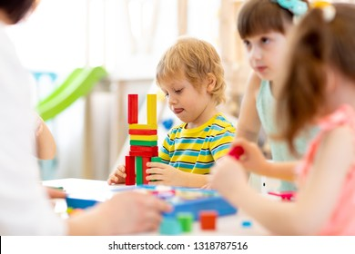 Kids playing with color block toys in kindergarten