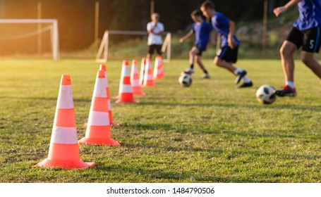 Kids Playing Football Soccer Game on Sports Field