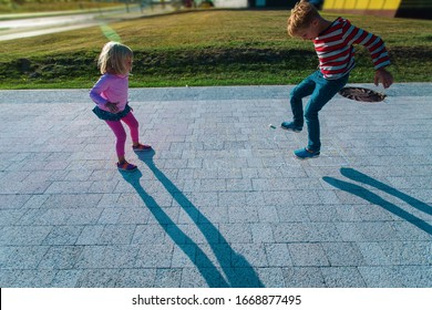 kids playing hopscotch on playground outdoors, playtime