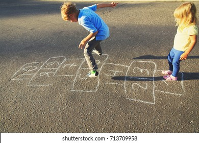 kids playing hopscotch on playground