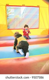 kids playing in inflatable air castle