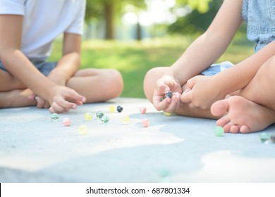 Kids playing marbles game outside