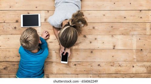 kids playing with mobile phone and tablet pc