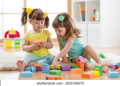Kids are playing with montessori toys in kindergarten