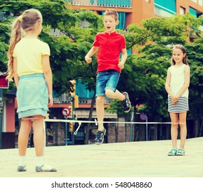 Kids playing at playground outdoors in summer