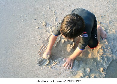 Kids playing in sand at the beach.