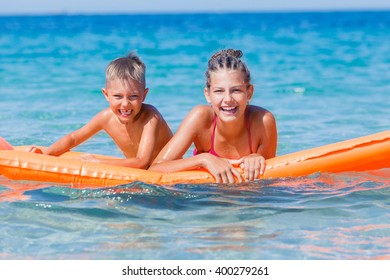 Kids playing in sea.