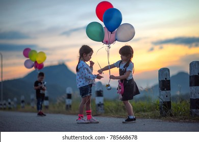 kids playing and sharing toys balloons together