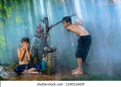 Kids playing and shower form the Groundwater pump,Children in countryside thailand,