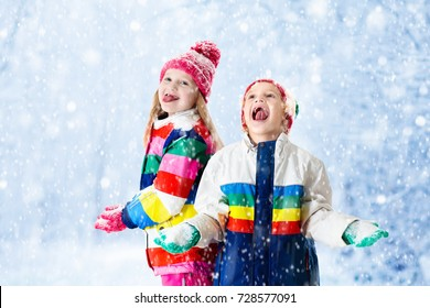 Kids playing in snow.