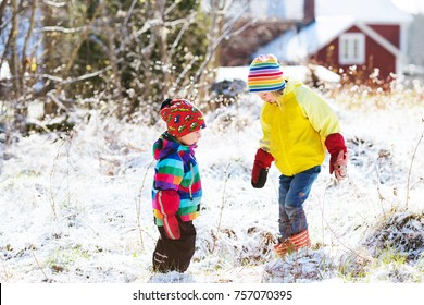 kids playing with snow. toddlers on swedish countryside. girl and boy on cold winter snowy day. outdoors family vacation. first snow in rural scandinavia.