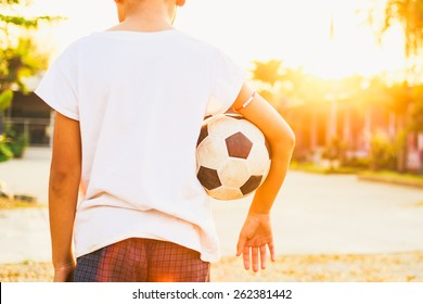 kids are playing soccer football for exercise under the sunlight.