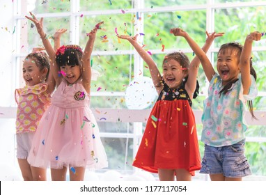 Kids are playing and throwing paper in kid party