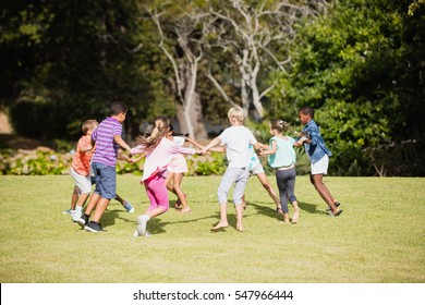 Kids playing together during a sunny day at park