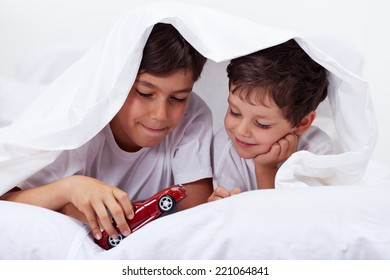 Kids playing together with toy car