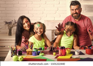 Kids playing with toys. Arts and crafts. Girls painters painting with mother and father. Entertainment, cosplay party and holiday. Learning and playing concept. Happy family showing hands colored in