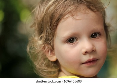 Kids playing with toys. Baby girl with green eyes on cute face and blond hair on natural environment. Child, childhood, family. Innocence, infancy, future concept