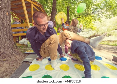 Kids playing twister game outdoors