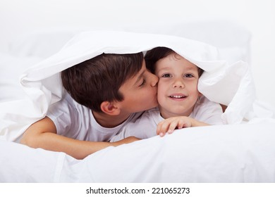 Kids playing under the quilt - brothers bonding