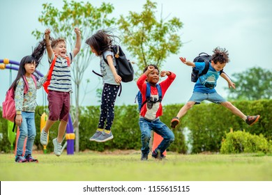 kids preschool kindergarten enjoy and happy jumping on the field of playground after school class is over to retuning home