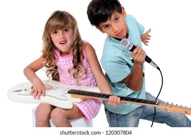 Kids pretending to be in a rock band