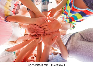 Kids are putting hands together, teamwork and friendship