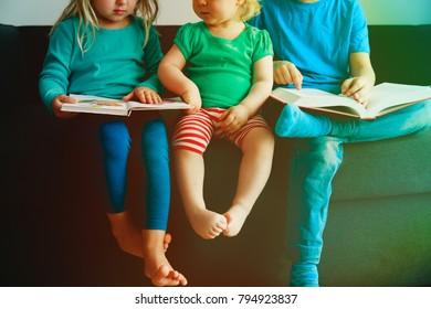 kids reading books at home, doing homework