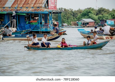 Kids are rowing a boat to school,Tonle Sap, Cambodia Ocyober 2016
