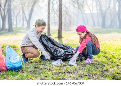 Kids scavenge trash in the spring park. Volunteer and ecology concept.