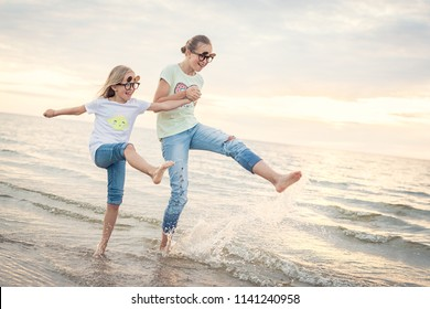 Kids at the sea. Two sisters playing and having good time at the seaside