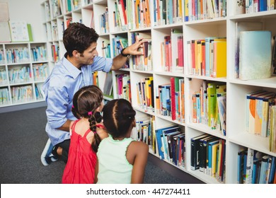 Kids selecting a book in a library