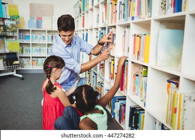 Kids selecting a book to read in the library