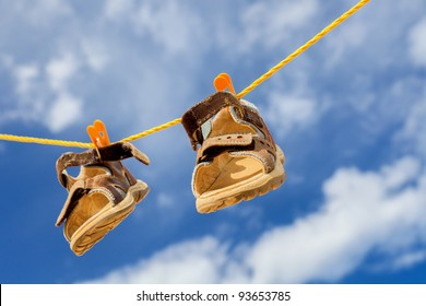 Kids shoes on rope