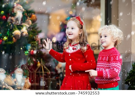 kids shopping for christmas presents children buy xmas decoration and tree little girl and - What To Buy A Girl For Christmas