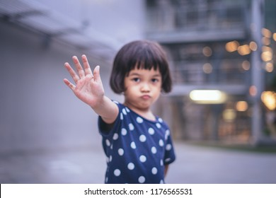 Kids showing STOP hand gesture.Little girl with STOP gesture.Child domestic violent concept.SELECTIVE FOCUS SHOT.