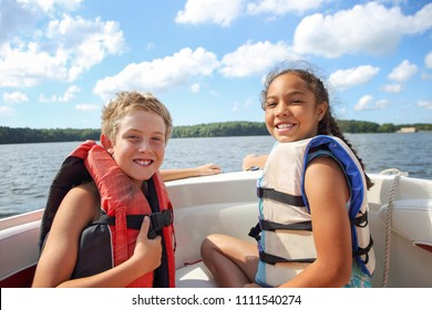 Kids sitting in a boat on the lake