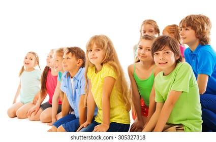 Kids sitting listening to teacher