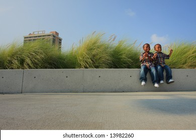 Kids Sitting on a Ledge to the Right